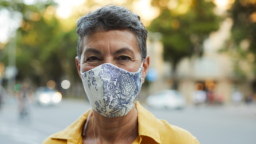 Woman wearing a mask on the street