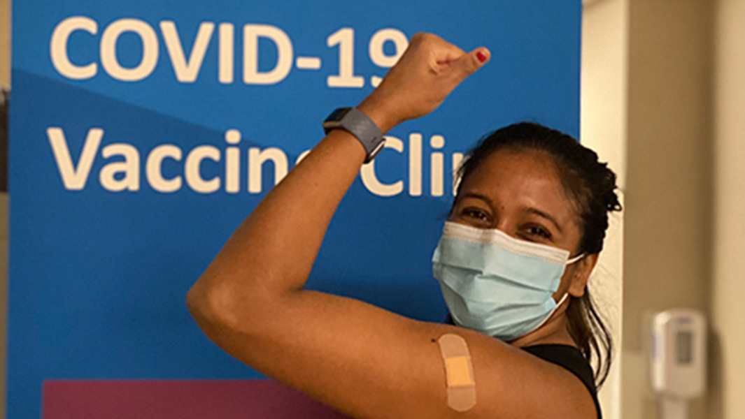 Happy person after receiving a COVID-19 vaccine