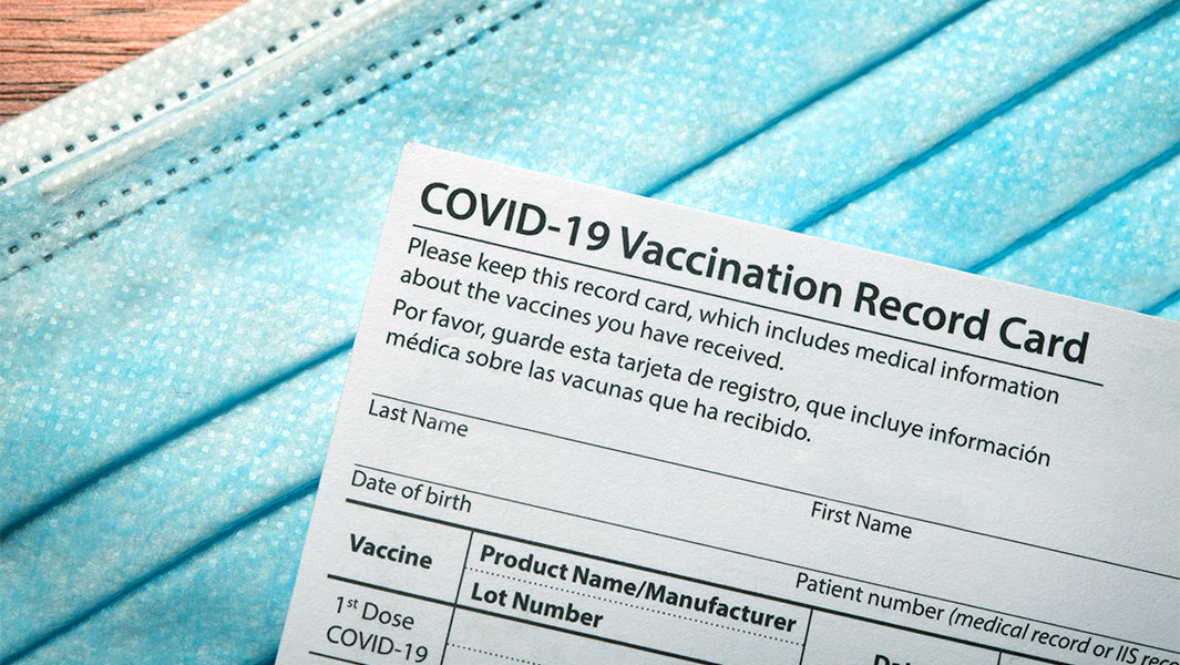 COVID-19 Vaccine Record Card and mask